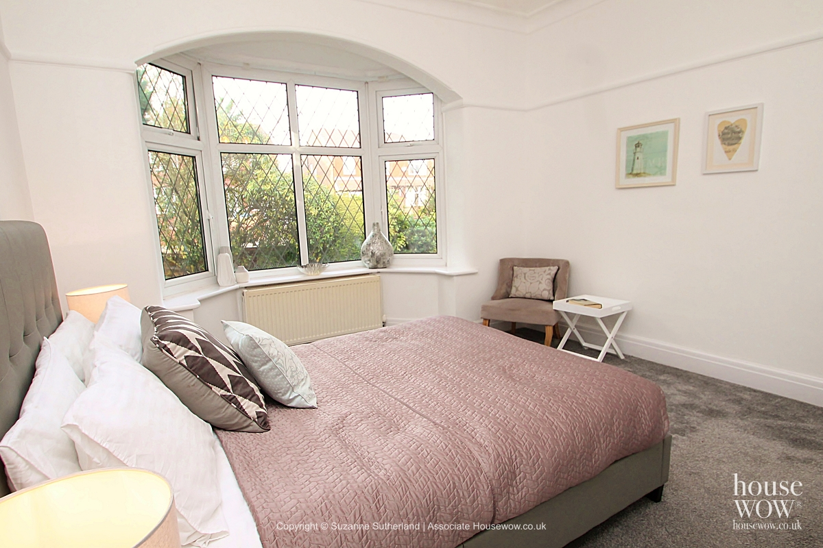 Staging with bay window in a Bedroom