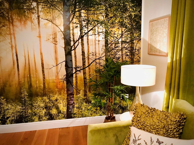 Interior with a forest mural depicting interior design for wellbeing and the natural environment being reflected in our homes
