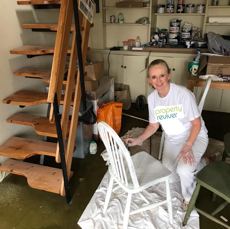 Amanda Caley, Interior Designer and Home Stager shown upcycling chairs by painting white for sustainable design